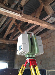 Laser scanner in barn with exposed roof timbers
