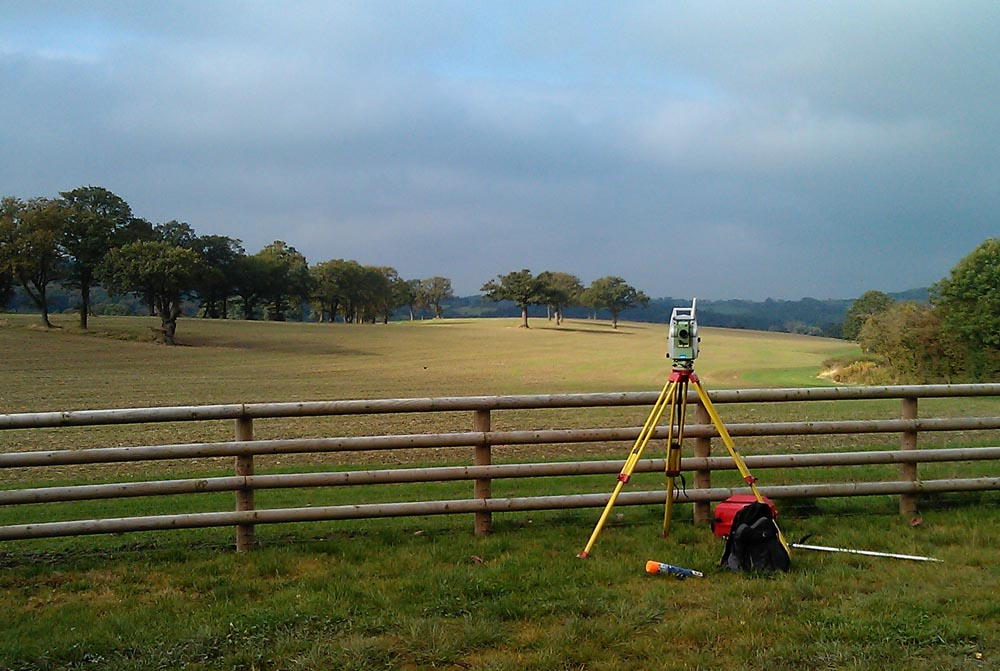Surveying equipment by fence