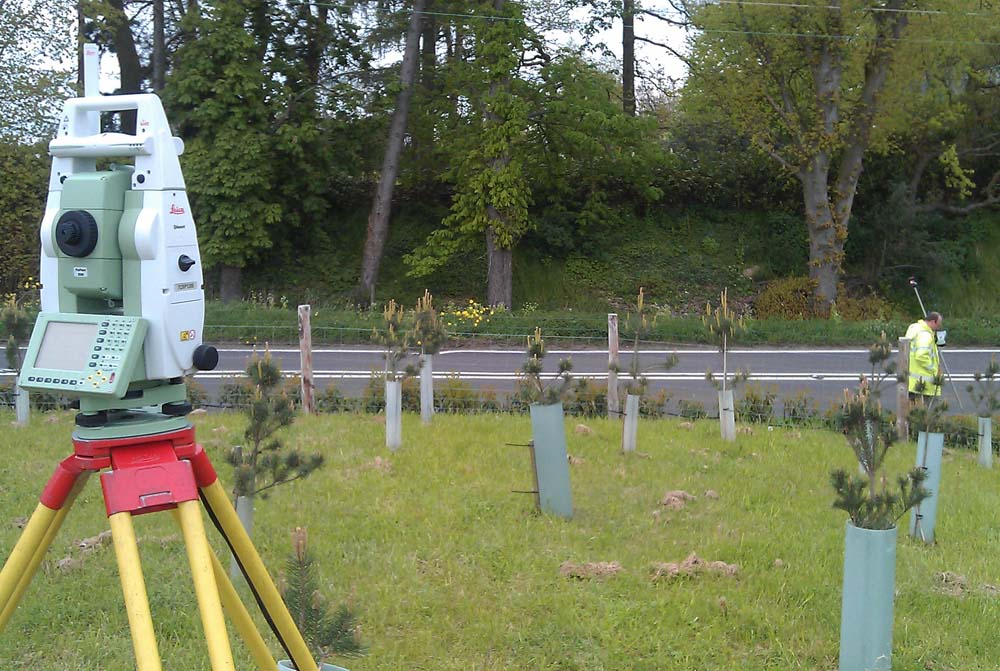 Surveyor carrying out topographical survey
